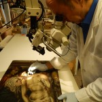 Examining and restoring a 17th Century French altar panel.